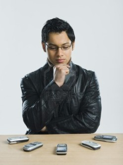 10167481-man-looking-at-mobile-phones-and-thinking
