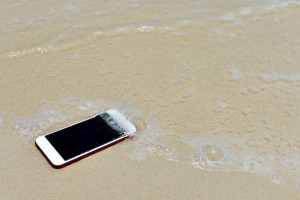 Lost Phone.Phone fell Disappear at beach for background